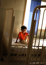 Parwesha Bibi, 4, waits to be treated for stomach pain inside the Children's Hospital at the Pakistan Institute of Medical Sciences, P.I.M.S., in Islamabad, Pakistan on Sept. 18, 2007.