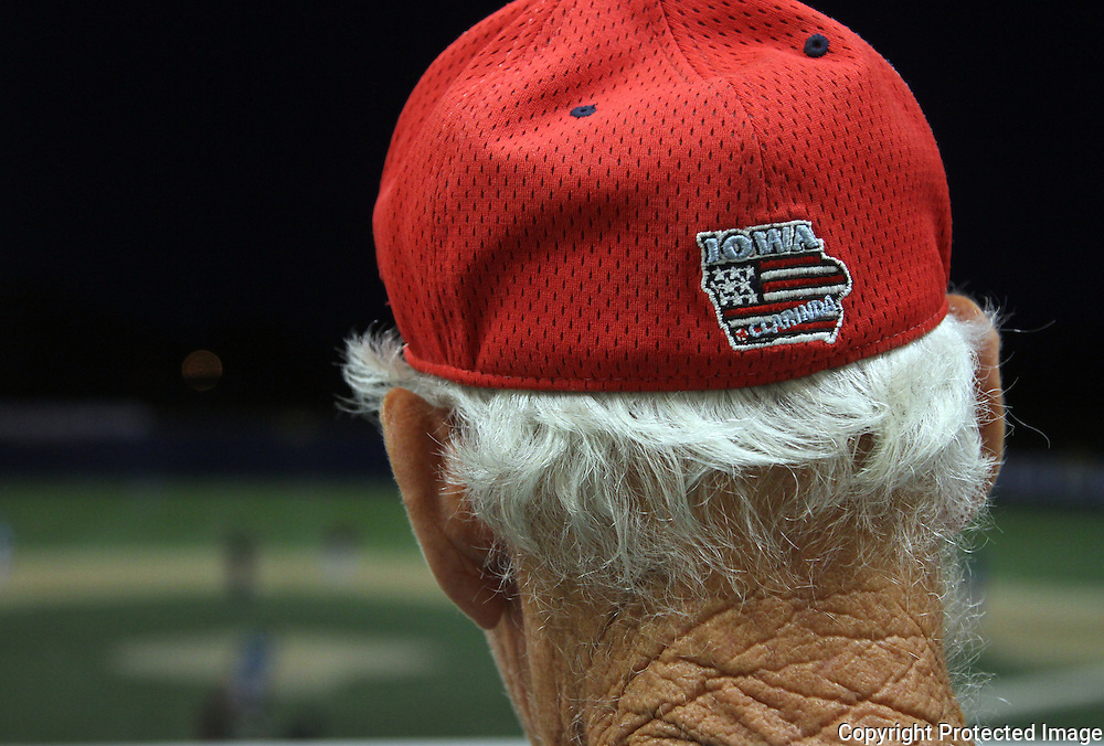 A.s scorekeeper Edwin Ratashak observes the game from the press box.  photo by David Peterson