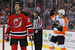 Jan 21; Newark, NJ, USA; Philadelphia Flyers right wing Matt Read (24) celebrates his goal while New Jersey Devils right wing David Clarkson (23) skates away during the second period at the Prudential Center.