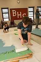 "Kelly Hayes and Emma Lacey paint new backdrops during ""Tech Day"" for Once Upon a Mattress at Belmont High School on Saturday.  (Karen Bobotas/for the Laconia Daily Sun)"