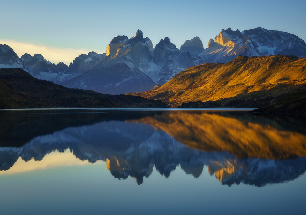 Los Cuernos reflection in perfectly calm waters, Torres del Paine National Park, Chile