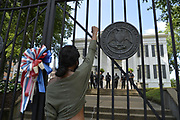 """6/6/2020 Jackson MS. <br /> Pictured is Jaila Williams, 21, with her fist in the air outside the Governors mansion in after a peaceful protest by Black Lives Matter.  She spoke of a change that is sweeping across the world, to end systematic racism and police brutality. As a black woman  in America she said how could she not be there in support.<br /> <br /> Protestors of all ages and races gathered out side the Governor Mansion after a peaceful protest by Black Lives Matter, organized by 18 yr old student Maisie Brown.   As the crowd chanted """"I can't breathe """" check his pulse.""""   and """" justice for George Floyd, in addition to """" no justice No Peace in the 90 degree heat. Photo© Suzi Altman<br /> <br /> Student Maisie Brown 18yrs old from Jackson organized a peaceful protest outside the Governors Mansion. She said there voices would be heard and her face would be seen- change is coming. The protest was in honor of George Floyd and in support of ending systematic racism and to end police brutality in Mississippi and America. The National Black Panthers Party from Tupelo Mississippi showed up outside the Governors mansion in the shadow of the State Capitol to protest police brutality. The National Black Panthers Party was their to show their support for change in Mississippi, to end systemic racism and police brutality. Protests have broken out around the world in solidarity to end white supremacy and police brutality. The Panthers showed up at the end of a peaceful protest organized by 18yr old student Maisie Brown. The brutal murder of African American George Floyd by the knee and hands of 4 former Minneapolis Minnesota police officers has sparked a cry for justice and reform around the world. Photo copyright © Suzi Altman @suzialtman #mississippi #blm #blacklivesmatter #protest #icantbreathe #georgefloyd #endracism #policebrutality #documentary #history #suzialtman #iphonography #shotoniphone #zumapress #NBPP #panthers #blackpanthers #nationalblackpantherparty"""