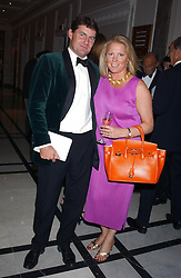 CHARLIE BROOKS and VISCOUNTESS GORMANSTON at the annual Ascot charity auction dinner this year in aid of The Princes Trust held at the Hyatt Churchill Hotel, Portman Square, London on 21st September 2004.<br />