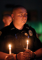 Blount County Sheriff's Officer Joseph Maus attends Sunday candle light and prayer vigil for the fallen Officer in Dallas Texas.Joy Kimbrough | The Daily Times