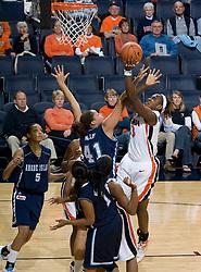 Virginia center Aisha Mohammed (33) shoots over Rhode Island center Whitney Hollis (41).  The Virginia Cavaliers women's basketball team defeated the Rhode Island Rams 89-53 at the John Paul Jones Arena in Charlottesville, VA on January 9, 2008.