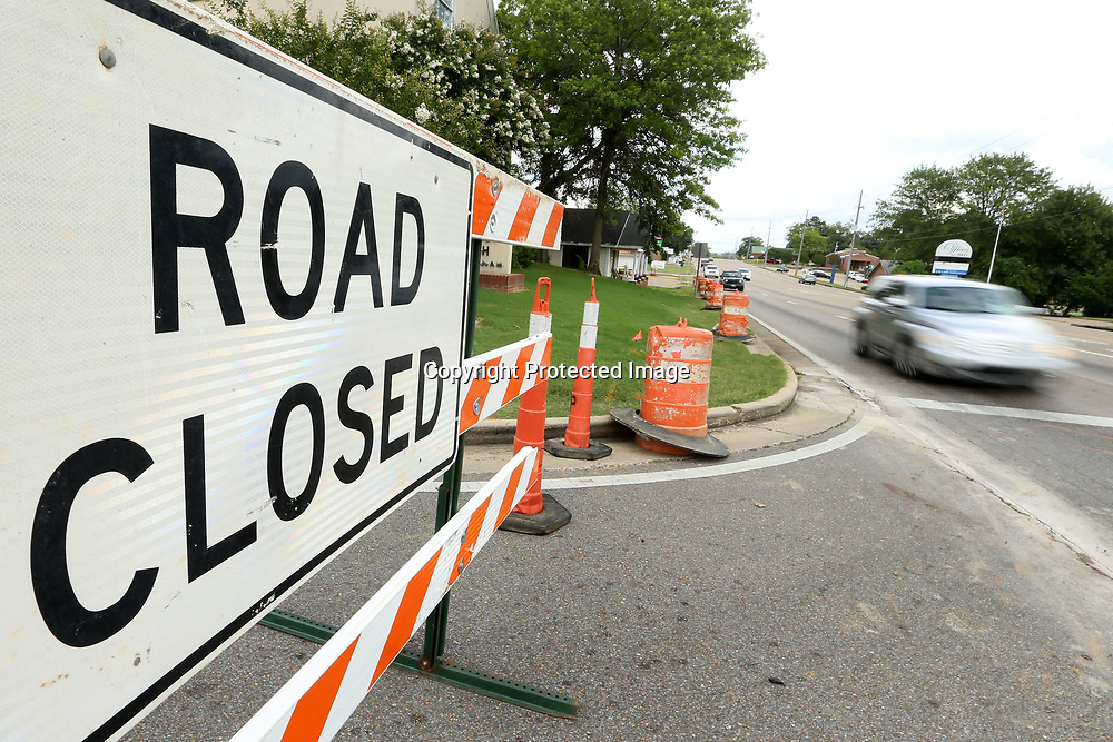 Traffic moves west on Main Street past the Lumpkin Ave intersection that is closed due to road work that will line up Lumpkin Ave with Monument Drive Tuesday in Tupelo.