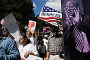 BIRMINGHAM, AL – OCTOBER 5, 2013: Jose Cabrera (right) marches past installations of the Birmingham Civil Rights Heritage Trail near Arthur Shores Park. The rally and march were organized by the Alabama Coalition for Immigrant Justice to voice support for immigration reform. CREDIT: Bob Miller for The New York Times