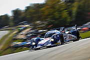 Chris Dyson, Guy Smith and Steven Kane, Dyson Racing Team Inc. (P1) Mazda Flybrid Lola B12/60 , Petit Le Mans. Oct 18-20, 2012. © Jamey Price