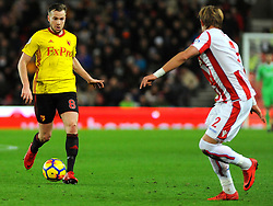 Tom Cleverley of Watford tries to get past Moritz Bauer of Stoke City  - Mandatory by-line: Nizaam Jones/JMP - 31/01/2018 - FOOTBALL - Bet365 Stadium - Stoke-on-Trent, England - Stoke City v Watford - Premier League