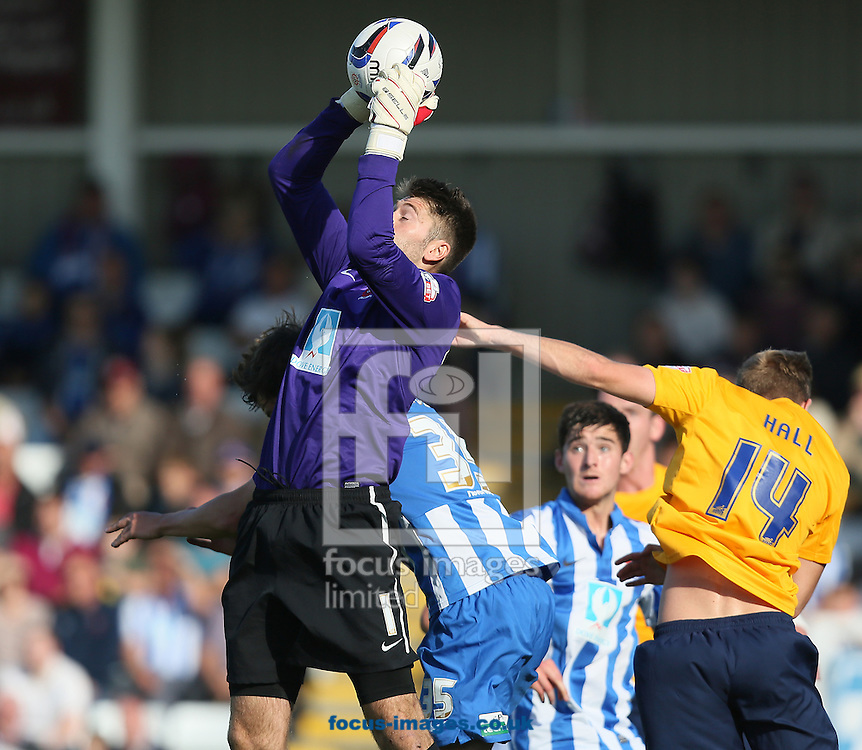 Picture by Paul Gaythorpe/Focus Images Ltd +447771 871632<br /> 28/09/2013<br /> Hartlepool United keeper Scott Flinders claims a cross from Asa Hall of Oxford United during the Sky Bet League 2 match at Victoria Park, Hartlepool.