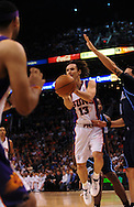 Mar. 19 2010; Phoenix, AZ, USA; Phoenix Suns guard Steve Nash (13) makes a pass in the first half at the US Airways Center. Mandatory Credit: Jennifer Stewart-US PRESSWIRE.
