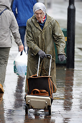© Licensed to London News Pictures. 06/11/2013<br /> Wet weather today (06.11.2013) in Kent.<br /> A rainy day for this elderly shopper at  Orpington High Street,Kent.<br /> Photo credit :Grant Falvey/LNP