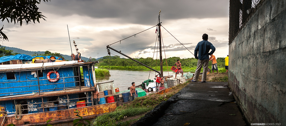 The monthly supply ship unloading goods under the watchful eye of it's captain, Boca de Sabalo (Sambu), Darien Province, Panama.