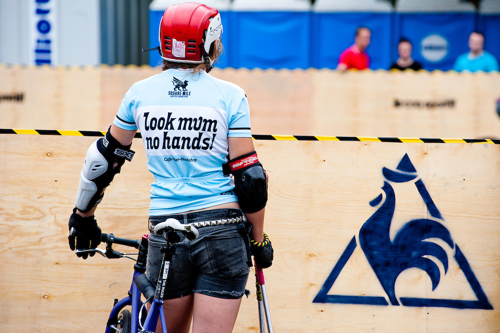 London, UK - 24 August 2012: one of the players wears a jersey reading 'look mum no hands!' during the Hell's Belles Vol 2, Ladies Bike Polo Tournament in Bethnal Green Gardens.