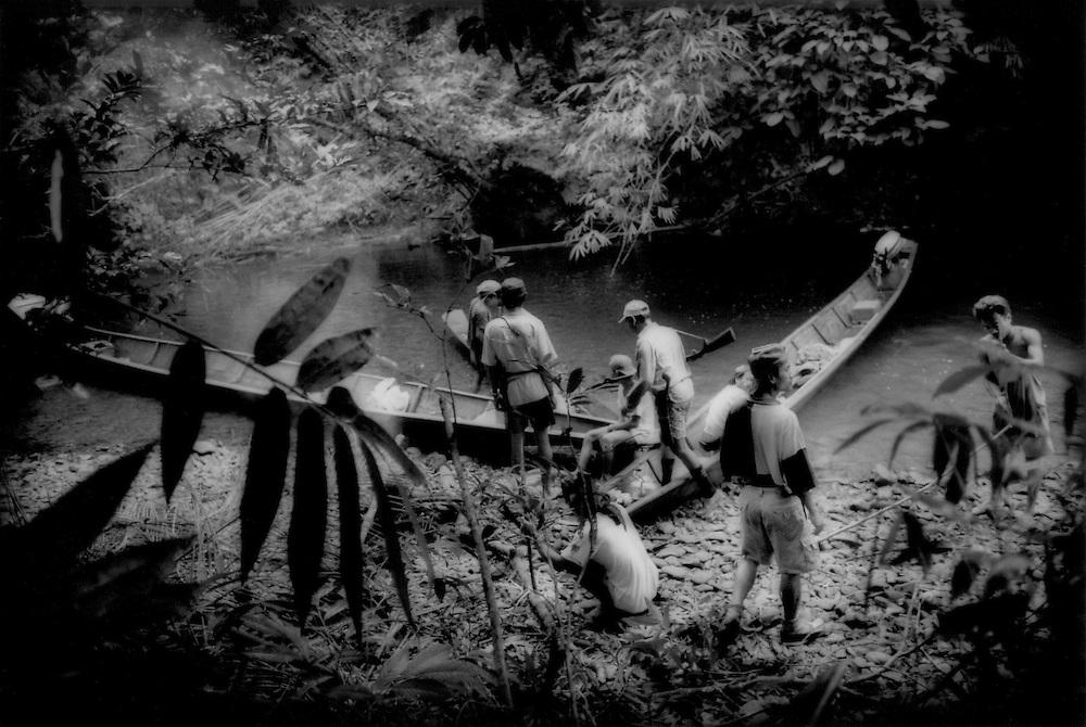 Dayak hunting party deep in the rainforest, Sungai Lalang River, Sarawak, Malaysian Borneo.