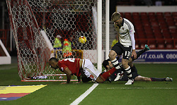 Chris O'Grady of Nottingham Forest (L) scores his sides second goal - Mandatory byline: Jack Phillips / JMP - 07966386802 - 5/12/2015 - FOOTBALL - The City Ground - Nottingham, Nottinghamshire - Nottingham Forest v Fulham - Sky Bet Championship