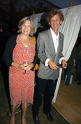MR MATHEW & LADY ANNE CARR at a party to celebrate the publication of Notting Hell by Rachel Johnson held in the gardens of 1 Rosmead Road, London W11 on 4th September 2006.<br />