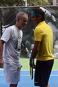 l to r: John McEnroe and Raphael Nadal at the Nike Youth Tennis  Challenge held at The Nike -Built regulation Tennis Court  on West 23rd Street & Broadway in New York  City . ..Hundreds of tennis fans and youth form New York  Parks and Rec. Athlethes for Charity, and Mentoring USA are treating to tips and guidance from Tennis Pros Roger Federer, Rafael Nadal and Serena Williams...