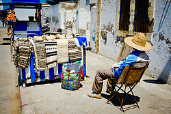 A stall holder relaxes in the sun in Essaouira, Morocco<br /> <br /> (c) Andrew Wilson | Edinburgh Elite media