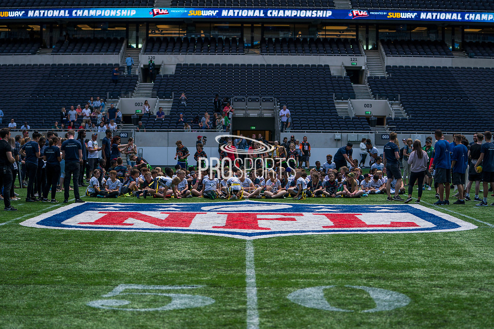 The kids begin to line up ahead of todays NFL Flag National Championship Finals during the NFL UK Media Day at Tottenham Hotspur Stadium, London, United Kingdom on 3 July 2019.
