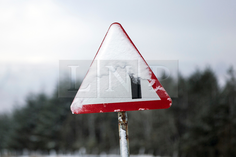© Licensed to London News Pictures. 16/04/2016. Ribblehead UK. Picture shows snow covered road sign's this morning after last night's snow fall in the Yorkshire Dales. Photo credit: Andrew McCaren/LNP