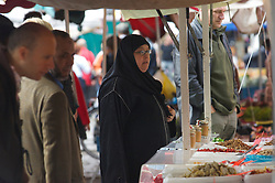 ANTWERP, BELGIUM - OCT-7-2006 - Muslims in Antwerp easily mix with the local population at an outdoor market in Antwerp's city center. Immigrants in Belgium have come under attack from the Flemish extreme right political party, the Vlaams Belang, which espouses an anti-immigration policy. (Jock Fistick / For the New York Times)