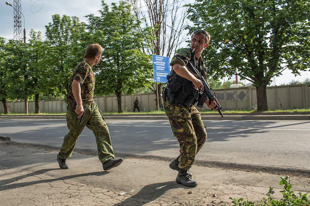 DONETSK, UKRAINE - MAY 26: Pro-Russian separatist fighters take positions outside the Donetsk airport, scene of an hours-long battle between pro-Russian separatists and Ukrainian forces, on May 26, 2014 in Donetsk Ukraine. A day after businessman Petro Poroshenko won Ukraine's presidential election, separatists occupied the airport, leading to a military response. (Photo by Brendan Hoffman/Getty Images)