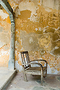 Chair on veranda of central courtyard. Details from an old traditional home on the Jaffna peninsula.