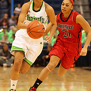 Skylar Diggins, Notre Dame, in action against Bria Smith, (right) during the Notre Dame Fighting Irish V Louisville Cardinals Semi Final match during the Big East Conference, 2013 Women's Basketball Championships at the XL Center, Hartford, Connecticut, USA. 11th March. Photo Tim Clayton