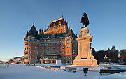 Samuel de Champlain monument, by Paul Chevre, erected 1898, in honour of the founder of Quebec City, on the Dufferin Terrace, and the Chateau Frontenac, opened 1893, designed by Bruce Price as a chateau style hotel for the Canadian Pacific Railway company or CPR, in Quebec City, Quebec, Canada. The building was extended and the central tower added in 1924, by William Sutherland Maxwell. The building is now a hotel, the Fairmont Le Chateau Frontenac, and is listed as a National Historic Site of Canada. Samuel de Champlain, 1574-1635, was a navigator who founded New France and Quebec City and mapped the Canadian coast. The Historic District of Old Quebec is listed as a UNESCO World Heritage Site. Picture by Manuel Cohen