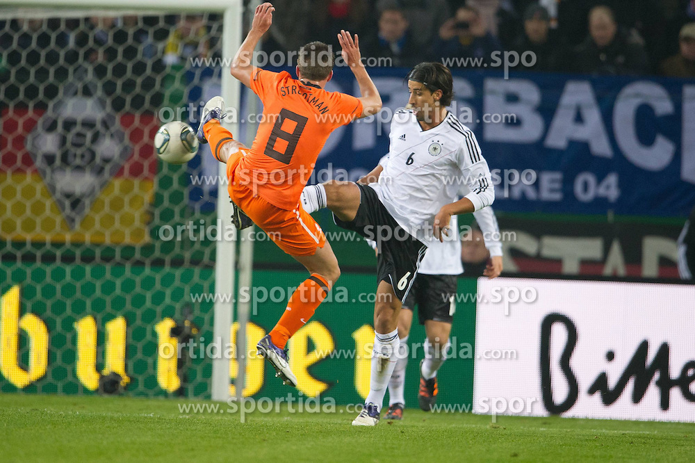 15.11.2011, Imtech Arena, Hamburg, GER, FSP, Deutschland (GER) vs Holland (NED), im Bild Zweikampf zwoschen Sami Khedira (GER #06 Madrid) und ned08 // during the Match Gemany (GER) vs Netherland (NED) on 2011/11/15, Imtech Arena, Hamburg, Germany. EXPA Pictures © 2011, PhotoCredit: EXPA/ nph/ Kokenge..***** ATTENTION - OUT OF GER, CRO *****