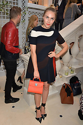BECKY TONG at a cocktail party to mark the opening of the House of Dior, the United Kingdom's largest and premier Dior boutique at 160-162 New Bond street, London on 8th June 2016.