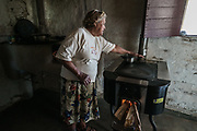 """Honduras. New Envirofit stove provided by the Honduran government. Often families who have switched to cleaner cooking stoves still practice """"stove stacking"""" which is using more than one type stove at a time, usually the traditional stove and the cleaner one. Some use the traditional stove for specific types of traditional food and some use both at the same time. It can take time for the family cook, usually the woman, to switch completely to the cleaner cooking stove."""