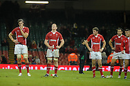 Wales players Luke Charteris (l), Bradley Davies, Rhys Priestland and Mike Phillips ® show their dejection after losing the match. Dove Men series, autumn international rugby international, Wales v Samoa at the Millennium stadium,  Cardiff in South Wales on Friday 16th November 2012.  pic by Andrew Orchard, Andrew Orchard sports photography,