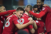 Accrington Stanley celebrate as Accrington Stanley Midfielder Sean McConville (11) scores a goal 0-2 during the EFL Sky Bet League 2 match between Grimsby Town FC and Accrington Stanley at Blundell Park, Grimsby, United Kingdom on 30 December 2017. Photo by Craig Zadoroznyj.