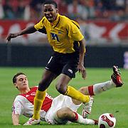 NLD/Amsterdam/20060928 - Voetbal, Uefa Cup voorronde 2006, Ajax - IK Start, Thomas Vermaelen in duel met Bala Armed Barba