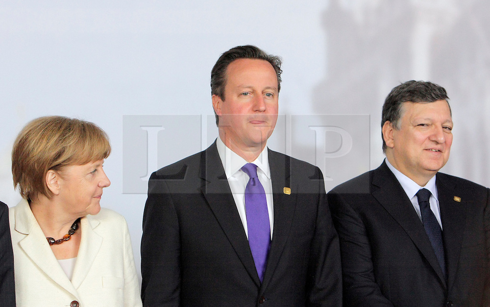 © Licensed to London News Pictures. 05/06/2014. Brussels, BELGIUM.<br /> L-R Angela Merkel, David Cameron and Jose Manuel Barroso at G7 SUMMIT Family Photo, 5/6/2014<br /> : RICH BOWEN/LNP