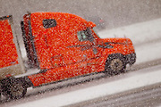 A semi truck-trailer truck drives on interstate 43 in Green Bay, Wisconsin during a snow storm in March 2011.(Photo by Mike Roemer)