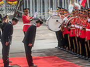 23 JULY 2015 - BANGKOK, THAILAND:  NGUYEN TAN DUNG (center), Prime Minister of Vietnam,  and PRAYUTH CHAN-O-CHA, Prime Minister of Thailand, (left)  bow to soldiers in the honor guard at Government House in Bangkok. The Vietnamese Prime Minister and his wife came to Bangkok for the 3rd Thailand - Vietnam Joint Cabinet Retreat. The Thai and Vietnamese Prime Minister discussed issues of mutual interest.     PHOTO BY JACK KURTZ
