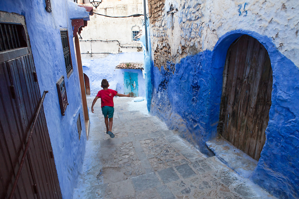 A young boy in the old blue medina of Chefchaouen, Morocco.