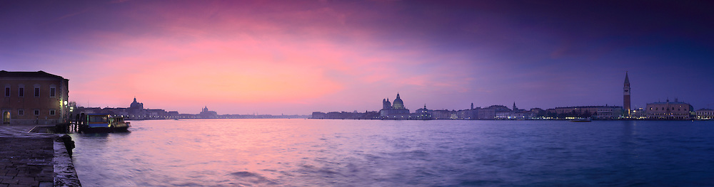 Some amazing colours over San Marco and the Giudecca. The sun is setting behind the Redentore and the haze spreads its colours in the sky. Taken on evening of mid January from San Giorgio Maggiore, this is stitched from thirteen vertical frames.