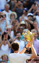 Andy Murray  with the trophy after winning  the Men's Final at the Wimbledon Tennis Championships in  London, Sunday, 7th July 2013<br /> Picture by Stephen Lock / i-Images