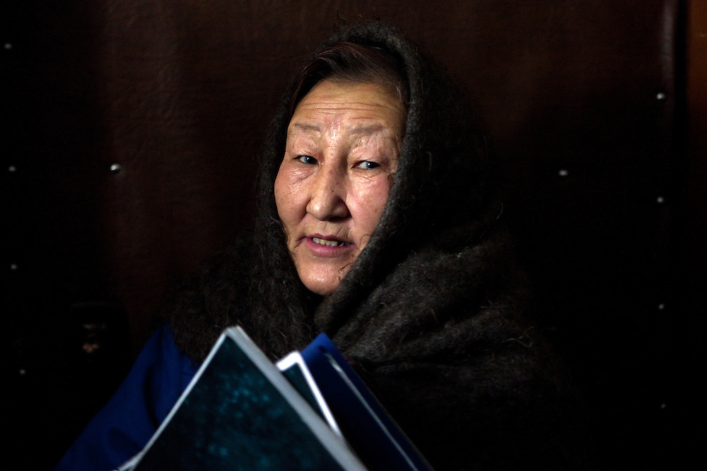 Portrait of Tamara Jegorovna - a teacher in pension - daughter of a meteorologist, chronicler, writer who knows everything about the cold at her home in the village. The area is extremely cold during the winter. Two towns by the highway, Tomtor and Oymyakon, both claim the coldest inhabited place on earth (often referred to as -71.2°C, but might be -67.7°C) outside of Antarctica. The average temperature in Oymyakon in January is -42°C (daily maximum) and -50°C (daily minimum). The images had been made during an outside temperature in between -50°C up to -55°C. Oymyakon, Oimjakon, Yakutia, Jakutien, Russian Federation, Russia, RUS, 20.01.2010
