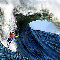 A huge barrel forms behind surfer Russell Smith, of Santa Cruz, California  as he challenges a Mavericks monster during the annual Mavericks Surf Contest on March 2, 2005.  The contest takes place in a legendary break in the Pacific Ocean one-half mile off the coast of Half Moon Bay, California .  Photo by Shmuel  Thaler / Santa Cruz Sentinel