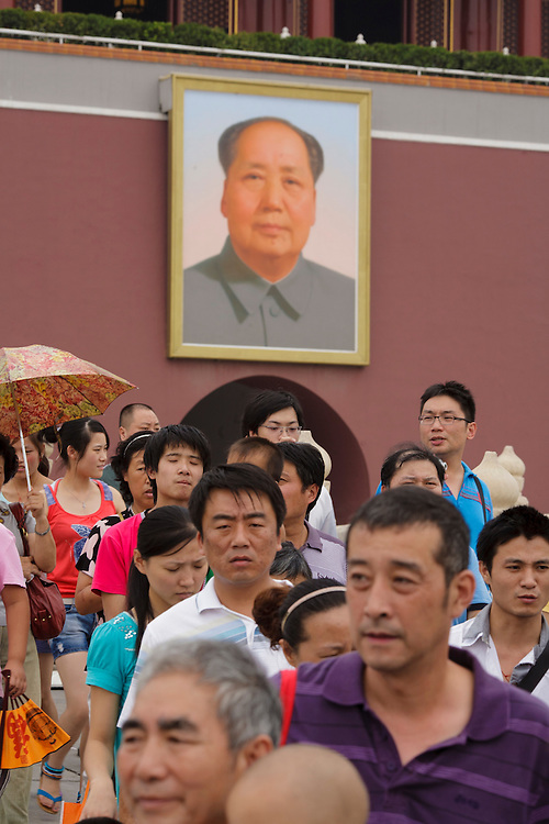 Crowds at Tian'anmen Square with the facade of Forbidden City in the background, with Mao Zedong painting.