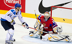 Mikko Koivu of Finland vs Konstantin Barulin of Russia during shootout during ice-hockey match between Russia and Finland of Group E in Qualifying Round of IIHF 2011 World Championship Slovakia, on May 9, 2011 in Orange Arena, Bratislava, Slovakia. Finland defeated Russia after overtime and shootout 3-2. (Photo By Vid Ponikvar / Sportida.com)