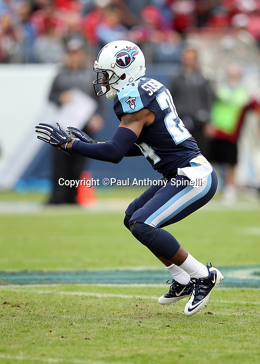 Tennessee Titans cornerback Coty Sensabaugh (24) chases the action during the 2015 week 7 regular season NFL football game against the Atlanta Falcons on Sunday, Oct. 25, 2015 in Nashville, Tenn. The Falcons won the game 10-7. (©Paul Anthony Spinelli)