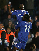 Photo: Paul Thomas.<br /> Chelsea v Levski Sofia. UEFA Champions League, Group A. 05/12/2006. <br /> <br /> Shaun Wright-Phillips (Top) celebrates his goal with Chelsea team mate Didier Drogba (11).