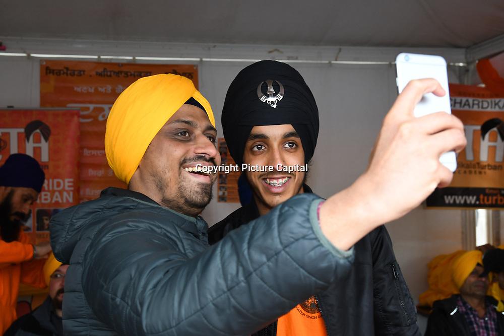 London, England, UK. 27 April 2019. Free Turbans at the Vaisakhi Festival is a Sikh New Year in Trafalgar Square, London, UK.
