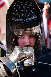 Competitor rests during the  International Medieval Combat Federation (IMCF) World Championships  at Scone Palace on May 12, 2018 at Scone Palace in Perth, Scotland.